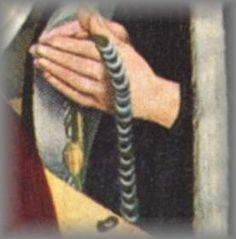 """eather thongs, found in European grave sites, are sewn into a circle. Bone rings are aligned and sewn into place like scales on the thong.  As prayers are counted the rings are turned over. Still in use as late as the 19th century in Southern Germany. St Jerome is praying one of these rosaries in the painting, 'St Jerome in the Desert"""" by Bono da Ferrara c 1440."""