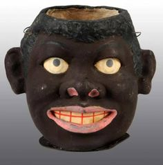 Rare antique head lantern - black memorabilia.  Pre-auction estimate: 3000 to 4000 dollars.