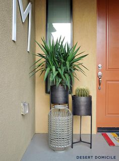 Add planters and plants in different heights to warm up your front door, just like @Caitlin @ Desert Domicile did!