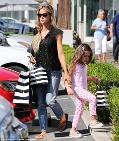 Back to basics: Denise Richards, 45, mostly kept her sartorial choices simple for the outing with two of her daughters, though she did add a bit of flare thanks to a black sleeveless top