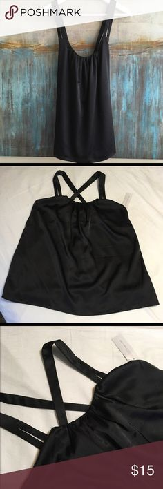 New York & Co Silky Top Size Small NY&Co silky top with criss cross straps, gathered scoop neckline and fully lined. New With Tags. Size Small. Color Black. Material Rayon/Spandex blend. Measurements: shoulders: 11, pits: 15, top to bottom: 27.5. New York & Company Tops Camisoles