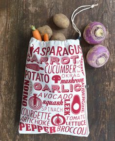Vegetable Preserving Bag - Red & Natural - Natural Collection Select - With a vibrant typography print, this handy canvas drawstring bag will keep your vegetables at their best for longer. Broccoli, Spinach, Stuffed Mushrooms, Stuffed Peppers, Okra, Typography Prints, Artichoke, Lettuce, Cucumber
