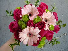 Love the raspberry-colored roses with the lighter pink gerber daisies. pink wedding flowers 2007 http://sophisticatedfloral.com/