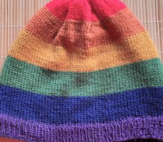 Hand - knitted Pride rainbow hat in wool for both men and women by Ebooksandhandmade on Etsy Rainbow Pride, Winter Day, Beanies, Rainbow Colors, Mittens, Hand Knitting, Knitted Hats, Pure Products, Wool