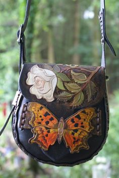 Sky Raven Wolf - white rose and comma butterfly hand carved and painted on a small dark cocoa brown handstitched bag