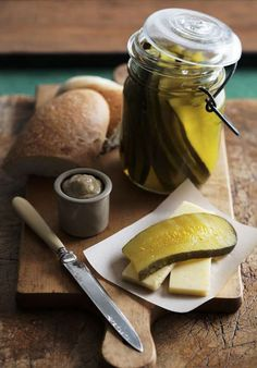 Dill Pickles    2 quarts water (1.9 liters)  1 quart cider vinegar (.95 liters)  3/4 cup canning salt (220g)  10 wide-mouth, pint mason jars  Approximately 25 pickles  2 bunches dill  tools: mandoline