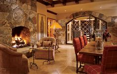 wine cellar with tasting room, maybe with less stone, and add a rug