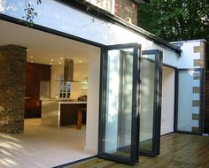 These bifold doors would look fantastic in my kitchen. My current sliding glass door is boring and ugly. Bifold doors would also let in several times the amount of sunlight. I might even be able to save a few dollars on my heating bill.