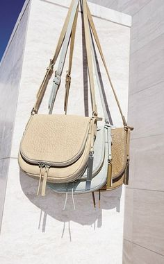 c7c010248 An exposed zipper accents these svelte crossbody bags from Vince Camuto.  Purses And Handbags,