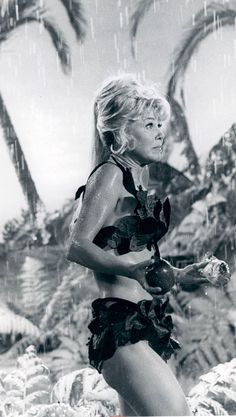 """3/22/14  2:12a   20th Century Fox  """"Move Over, Darling""""    It's Raining!   Doris Day  is wearing  her Leafy   'Jane'  outfit,  while living for 5 years  on the Island with Chuck  Conners.  Dinner: Fish and Fruit  1963 24.media.tumblr.com"""