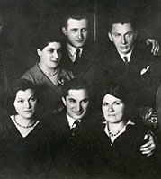 With his mother, brother Schlomo, sisters Betty and Regina, and family friends.