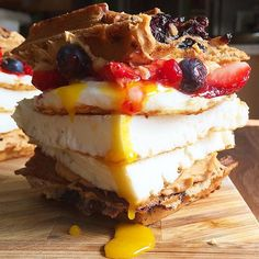 Today's lunch aka pre workout meal were some tasty PB&J Egg Waffle Sammies!  These bad boys were made up with my Blueberry waffles recipe with egg whites, fried runny egg, my low fat peanut butter recipe, sugar free strawberry jelly, and fresh blueberries & strawberries!  I have to thank @fitvshungry for giving me this idea awhile back so thanks again my friend!  Macros for each #wafflesandwich: 362 cals, 82g carbs, 17g fat, 60g protein  And of course my blueberry waffle recipe, my low fat…