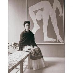 Frida Kahlo in front of The Acrobat (1930) by Pablo Picasso