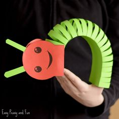 """This adorable 3D paper caterpillar craft is a cute and wiggly project to make with your kids! It can be a """"freehand"""" project or you can use our printable caterpillar craft template and cut along the lines. *this post contains affiliate links* Spring is the perfect time of the year to do bug crafts, and …"""