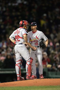 MATHENY IN HIS PLAYING DAYS..Mike Matheny #22 and Woody Williams #19 of the St. Louis Cardinals talk on the mound during game one of the 2004 World Series against the Boston Red Sox on October 23, 2004