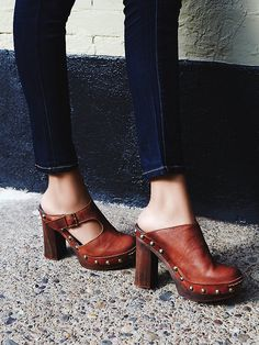 Wonders Clog | Washed leather clog heels, featuring Spanish craftsmanship. Statement studs and a side cutout add interest. Features an adjustable buckle closure.