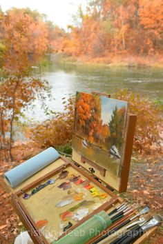painting at rivers edge,