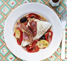 Any white fish fillets work well in this delicious light fish supper packed with flavours from the Mediterranean