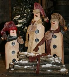 I have so many primitive snowmen that my house becomes well populated at Christmas ;)