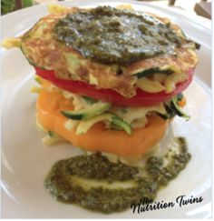 Zucchini Fritter Tomato Stacks |Only 150 Calories | Super Satiating |Easy To Make Breakfast |Feels Indulgent Yet Is Light and Healthy | For MORE RECIPES, Fitness & Nutrition Tips please SIGN UP for our FREE NEWSLETTER www.NutritionTwins.com @egglandsbest  .client