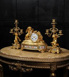 JAPY FRRES EARLY ORMOLU AND SVRES PORCELAIN CLOCK SET