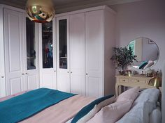 Pink and teal pastel bedroom. Light pink bedroom. Dressing table area. Large brass trim mirror. Bedroom decor. Bedroom Inspo. Pink Interiors. Painted build in wardrobes.