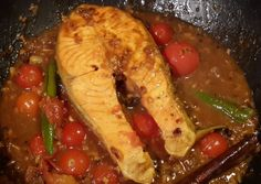 Salmon with Rick Stien's Meloo recipe, but tweeked to include home grown cherry toms. Lovely lovely dish with plain rice.