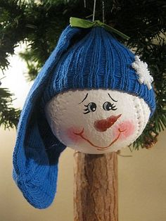 How cute and easy, it's a baseball, the hat is just a kids sock, the snowflake a button and the face wouldn't be too hard to paint. Love it!