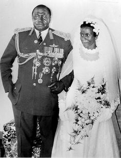 President of Uganda Idi Amin Dada poses with his new bride Lady Sarah Kyolaba after their wedding in August 1975