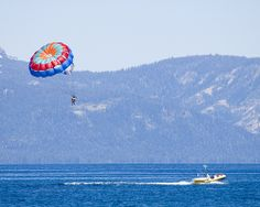 South Lake Tahoe - Zephyr Cove, Parasailing (not me!) / http://www.sleeptahoe.com/south-lake-tahoe-zephyr-cove-parasailing-not-me/