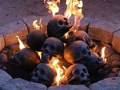 If I had a fireplace, you know these would be in it.  Love the macabre!