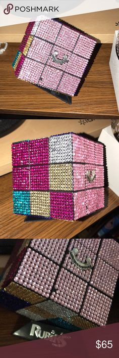 Juicy Couture Rubixs cube It has two crystals maybe three missing other than that in perfect condition. Very clean and well-kept always displayed on my little Rubiks cube holder. If you want the Rubiks cube holder with the item please tell me before shipping. Juicy Couture Accessories
