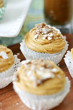 White Chocolate Alfajor Cupcakes with rich dulce de leche frosting.  A tribute to Argentina!