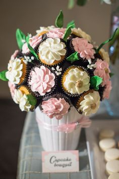 Such a lovely cupcake bouquet - spread several at the dessert table or place one on each reception table