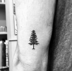 Guy With Small Tricep Tree Tattoo Design