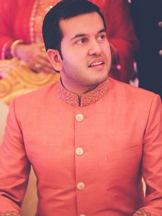 Indian Groom Wear - Coral groom sherwani | WedMeGood #wedmegood #sherwani #coral