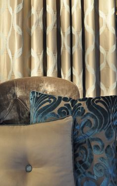 CHAIN CS FROM THE MOTION COLLECTION AS CURTAIN. ARIES AS CUSHION. MORESCO CS ON THE CHAIR.