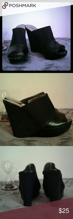 Carlos Santana black peep toe wedges Deep black suede backless wedges with leather and black zipper detail. These are ridiculously cute with bootcut jeans. Worn only a few times so no noticeable wear or known flaws. Carlos by Carlos Santana Shoes Wedges