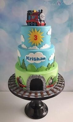 Thomas the tank engine cake - Cake by Mirka Cakes Thomas Birthday Cakes, Thomas Cakes, 4th Birthday Cakes, Birthday Ideas, 2nd Birthday, 3 Tier Cake, Tiered Cakes, Thomas Train, Friends Cake