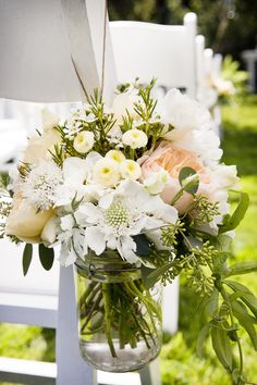 Hanging Glass Jars along the aisle, nice flower combination #ceremony