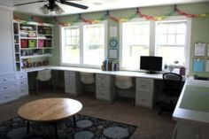 This is a great idea for multiple children to have personal, semi-permanent workspaces. It might be easier to maintain than a communal table, but I like the option of the table for joint projects.