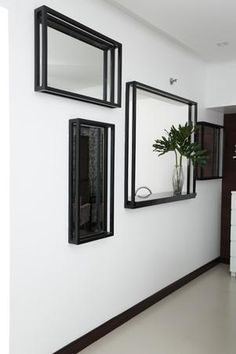 The other side of the pass-through window is disguised with more mirrors in black frames.