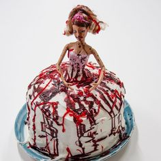 """They're-All-Gonna-Laugh-at-You Cake, Cake is no laughing matter when you add a fashion doll and plenty of """"blood"""" splatters a la Carrie. Place the doll in a simple homemade cake before you dress them both in fondant and icing. Use red food coloring for the signature blood. This super-sweet treat is sure to delight, gore and all."""