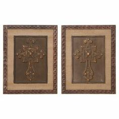 """Showcasing an ornate cross design with a riveted frame, this elegant wood and metal wall decor brings rustic appeal to your living room or foyer.   Product: Set of 2 wall decorConstruction Material: Wood and bronze alloyColor: Bronze and naturalDimensions: 18"""" H x 14"""" W x 1"""" D each"""