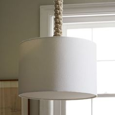 I like this idea for covering the plain, boring cord on my kitchen table light fixture. | Braided Rope Pendant | west elm
