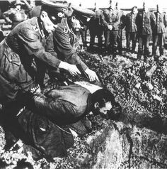 Nazi executions, two at a time. Note the usual crowd of well-wishers. A deep hole, these were probably just the first two of many more. Perhaps they are leaders to get this kind of special treatment. If you look very closely, the onlookers look almost jovial.