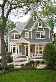Gorgeous Gray and White home exterior, Charming and inviting, Large front porch, shaker shingle siding