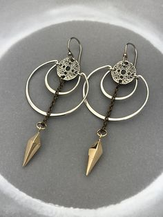 Scape Amulet Earrings with Silver Crescents and Bronze Spike Pendulum, . Moon Scape Amulet Earrings with Silver Crescents and Bronze Spike Pendulum, Moon Scape Amulet Earrings with Silver Crescents and Bronze Spike Pendulum, Gypsy Jewelry, Silver Jewelry, Silver Necklaces, Silver Earrings, Sunflower Jewelry, Silver Rings With Stones, Jewelry Photography, Bronze, Photo Jewelry