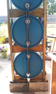 3 Drum Rain Collection System! This could save money on a water bill if you have a big garden!