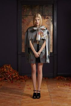 PATENT LATTICE MINI SKIRT WITH FLOATING LEAVES SILK AND NYLON TIE BLOUSE AND FLOATING LEAVES CAPE
